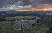 Germany, aerial view of solar fields near Halberstadt at evening twilight - PVCF000581