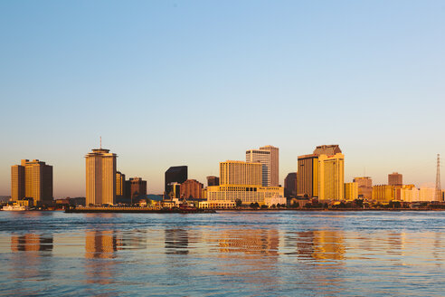 USA, New Orleans reflected in the Mississippi river at sunrise - GIOF000088