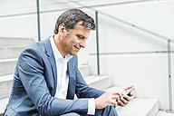 Businessman using smart phone - UUF005221