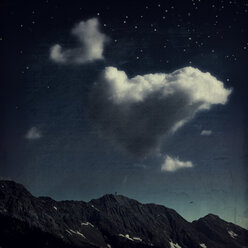 Clouds over mountain ridge, starry sky, digitally manipulated - DWIF000551