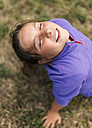 Portrait of girl with closed eyes relaxing on a meadow - MGOF000413