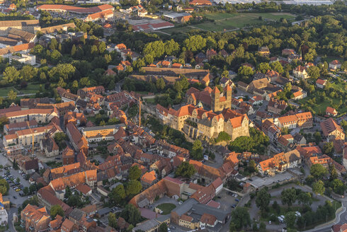Germany, aerial view of Quedlinburg with collegiate church at evening twilight - PVCF000588