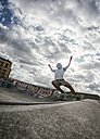 Young man skateboarding in a skatepark - MGOF000422
