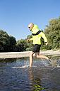 Man in sports wear running in water - MAEF010872