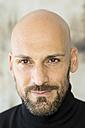 Portrait of staring man wearing black turtleneck - MAEF010896