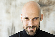 Portrait of staring man wearing black turtleneck - MAEF010895