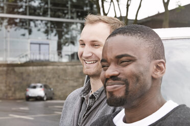 Two smiling men outdoors - STKF001379