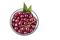 Bowl of sour cherries on white ground - CSF026136
