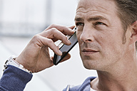 Man outdoors on cell phone - STKF001432