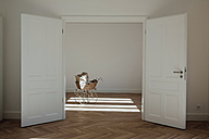 Pram in empty room, open doors - CHAF001056