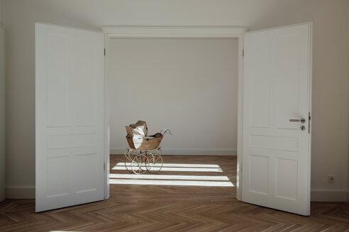 Pram in empty room, open doors - CHAF001056