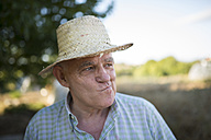Portrait of farmer with straw hat pouting mouth - RAEF000297