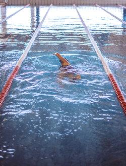 Female swimmer in indoor pool - EH000133