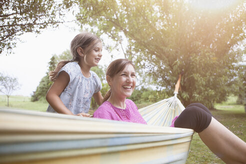 Relaxed mother and daughter in hammock - RBF003454