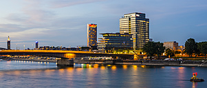 Germany, Cologne, Deutz Suspension Bridge and KoelnTriangle and Lanxess Tower, Blue hour - WGF000704