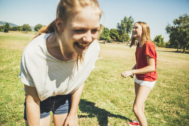 Two teenage girls having fun in park - AIF000044