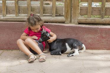 Little girl stroking a goat - ERLF000011