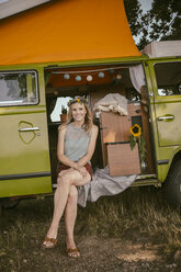 Hippie woman sitting in van in the nature - MFF002023