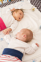 Newborn twins sleeping hand in hand - SHKF000350