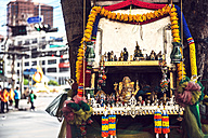 Thailand, Bangkok, street altar in a tree with Golden Ganesha statue and others - EH000155