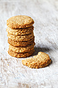 Stack of whole grain cocos cookies on wood - EVGF002079
