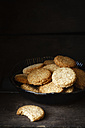 Bowl of whole grain cocos cookies  on dark wood - EVGF002083