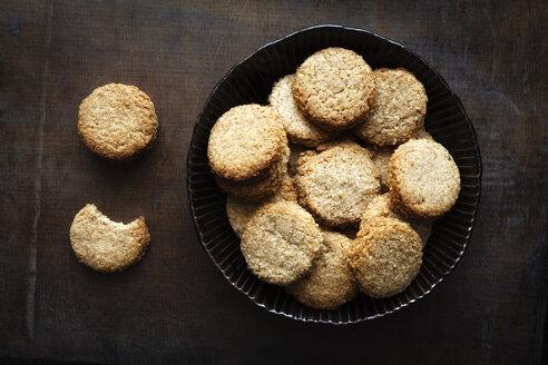 Bowl of whole grain cocos cookies  on dark wood - EVGF002088