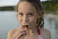 Portrait of girl with eating ice lolly - LBF001172