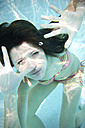 Portrait of young woman underwater in a swimming pool - TOYF001103