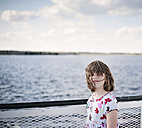 Girl on a ferry with blowing hair - CAMF000004