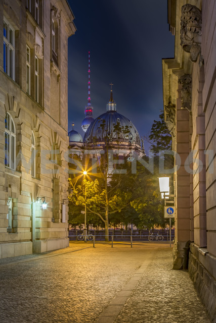 Germany, Berlin, Berliner Dom and TV-Tower seen through a narrow street at night - NKF000355 - Stefan Kunert/Westend61