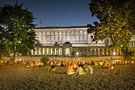 Germany, Berlin, People enjoying a warm summer night at the James Simon Park near the Spree river - NKF000347