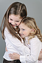 Two little sisters hugging - ECF001817