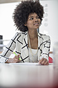 Young woman in office taking notes - ZEF007105