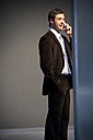 Confident businessman on the phone - TOYF001249