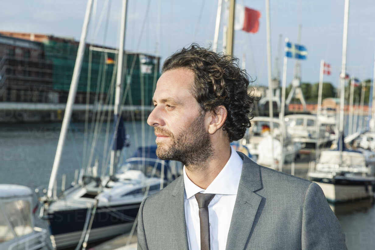 Germany, Luebeck, businessman at marina - FMKF001863 - Jo Kirchherr/Westend61