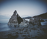 Spain, Ortigueira, rock formation at seafront of Picon beach, long exposure - RAEF000354