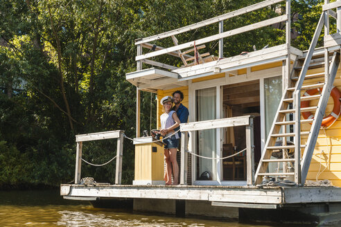 Couple having a trip on a house boat - FMKF001923