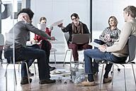 Colleagues in office having an informal meeting - ZEF007206