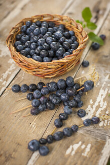 Blueberries in basket, skewered on wood - KSWF001557