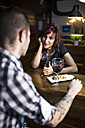 Young couple in modern restaurant having a rendezvous - JASF000010