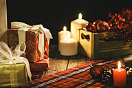 Christmas decoration with burning candles and checkered blanket - AKNF000022