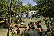 Croatia, Krka National Park, Skradinski buk, tourists bathing in pool at waterfall - BT000380