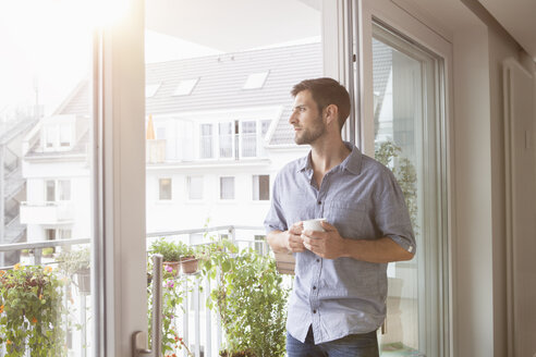 Serious man looking out of window - RBF003496