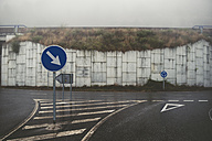 Spain, traffic signs on empty road at fog - RAEF000369
