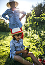 Senior woman and her granddaughter harvesting vegetables in the garden - MGOF000522