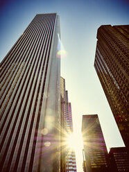 USA, Illinois, Chicago, High-rise buildings, Aon Center against sunlight - DISF002150