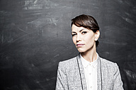 Portrait of a dark haired businesswoman - FMKYF000614