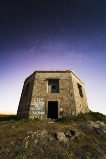 Spain, Ferrol, Monteventoso, ruin of a military building at moonlight - RAEF000405