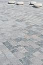 Germany, Travemuende, four stone seats on beach promenade - VIF000379